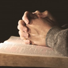 Prayer meeting holding