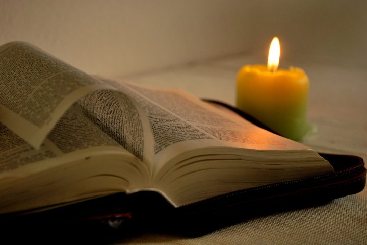 Bible study by candle light
