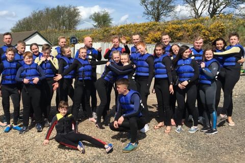 All posing for group shot before paddle baording
