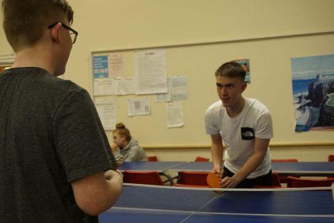 David and Josh playing table tenis